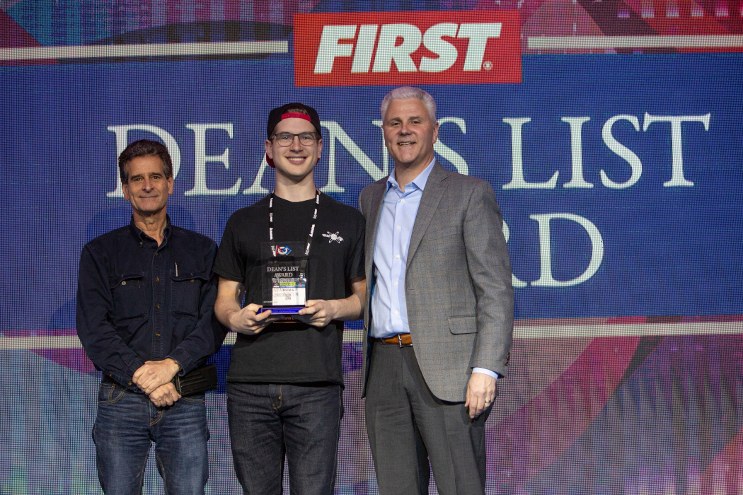Erik Boesen being awarded the Dean's List Award by FIRST founder Dean Kamen.