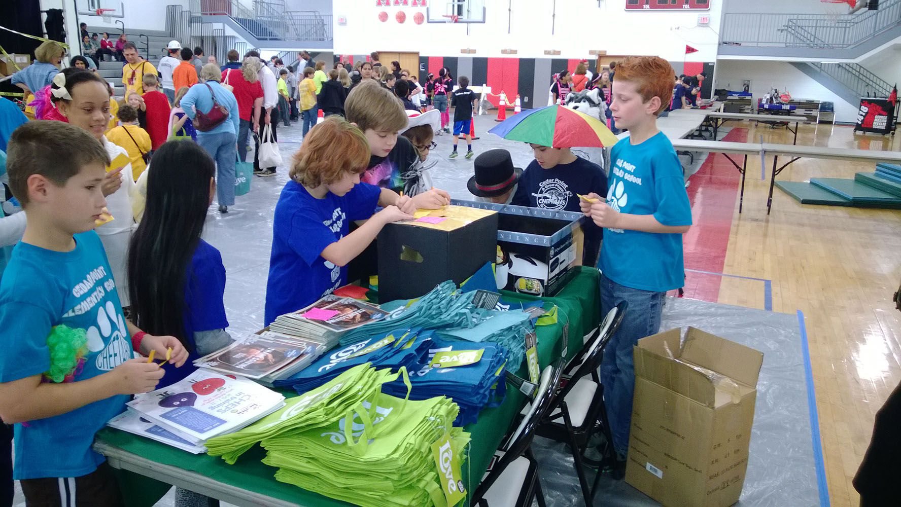 Students selling blue t-shirts.
