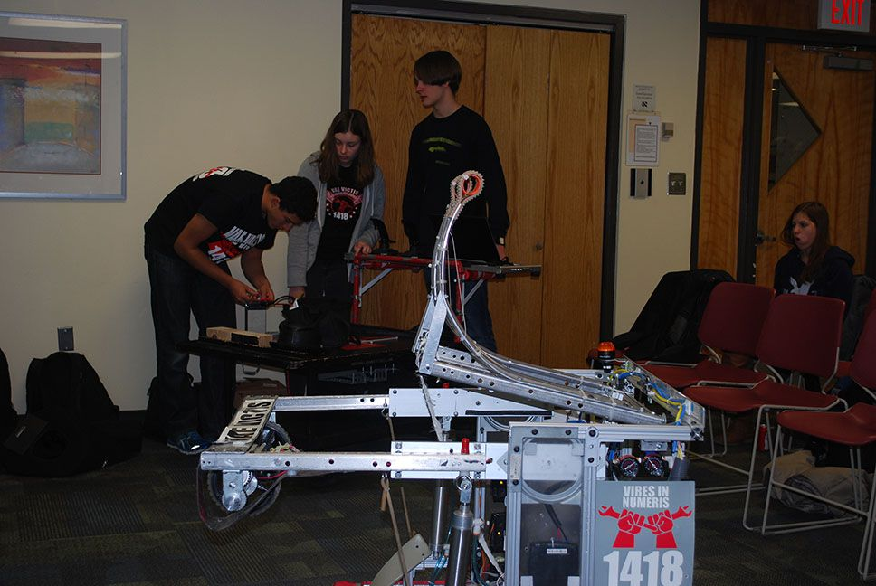 The robot with team members in the background.