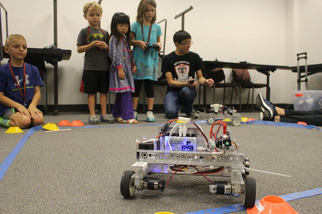 A team member demonstrating a small robot.