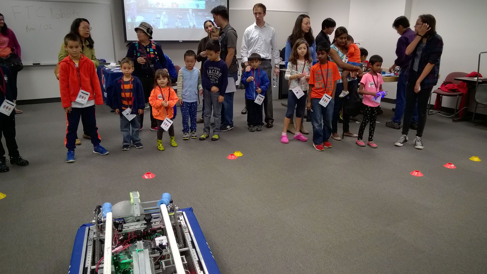Children and parents watching the robot.