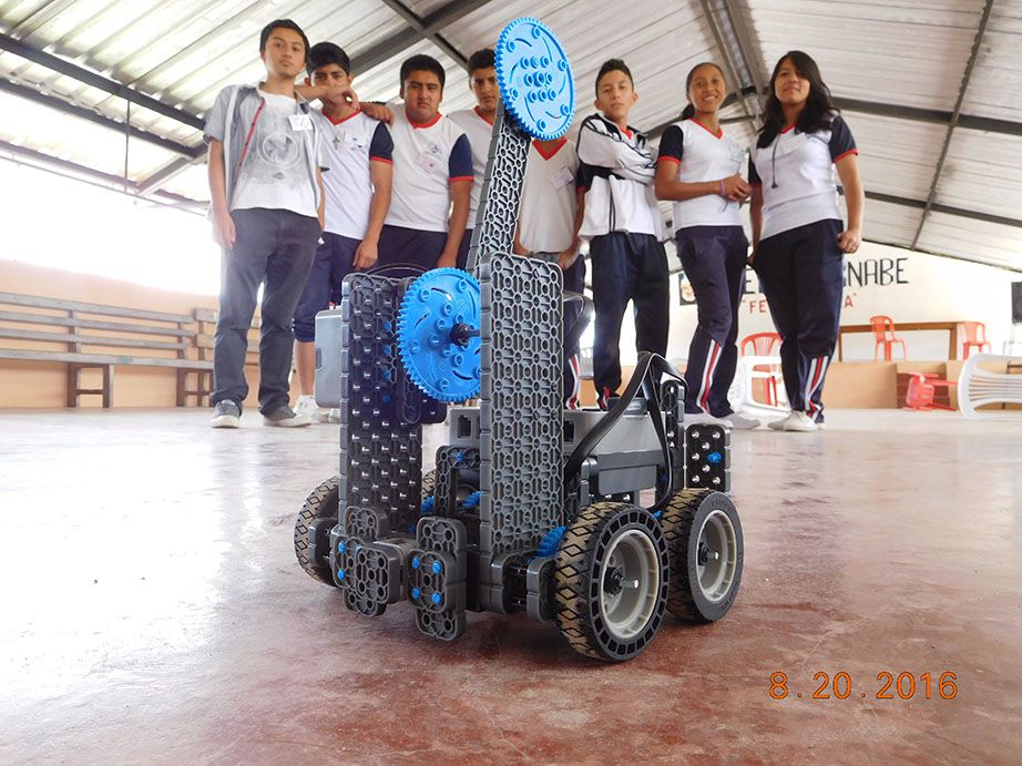 San Miguel de los Bancos students posing behind their finished robot.