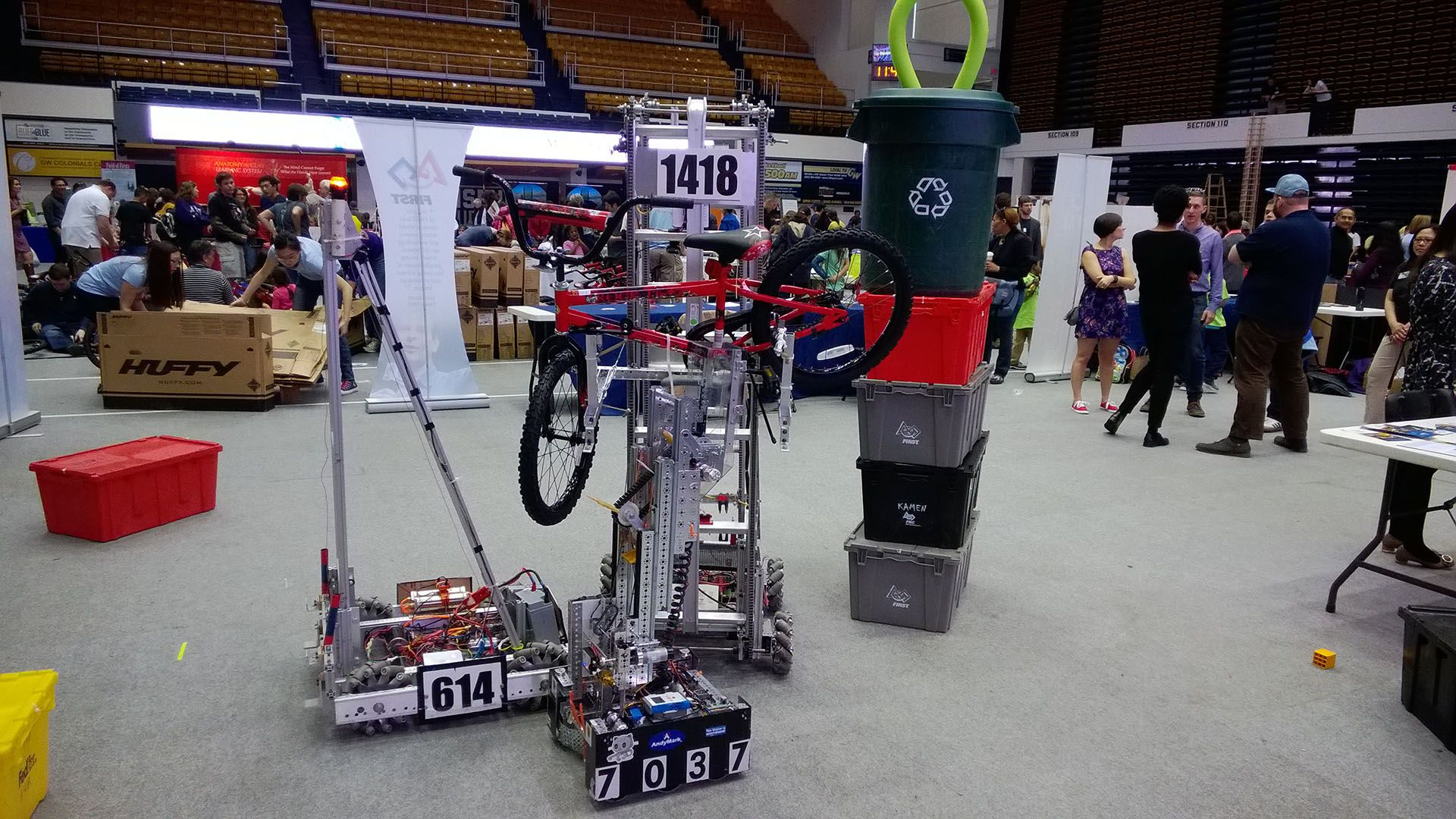 The 2015 robot holding up a red bike.